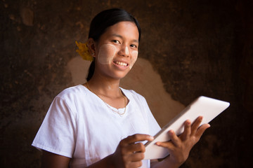 Myanmar girl using tablet computer