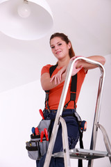 cute handygirl on ladder