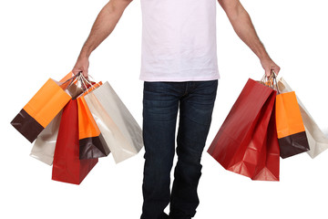 Man holding numerous shopping bags