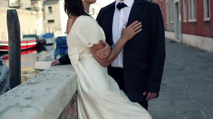 Just married couple on honeymoon in Venice, crane shot