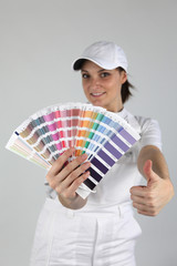 Decorator holding paint swatch