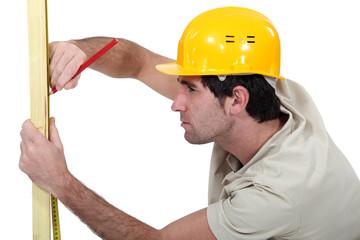 Carpenter marking plank