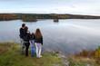 Family enjoy Swedish autumn landscape