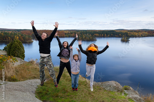 Family feel freedom in autumn scenery