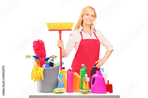 A female cleaner posing with cleaning equipment