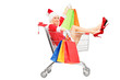 Female in christmas costume holding bags into a push cart
