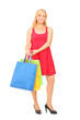 Smiling mature woman holding shopping bags