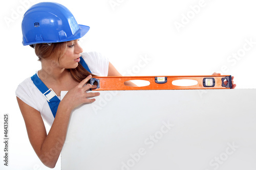 woman showing measuring tool