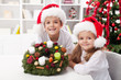 Kids holding advent wreath