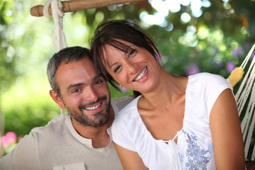 Couple sitting in hammock