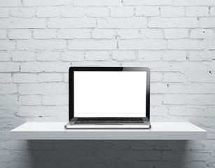 laptop on shelf