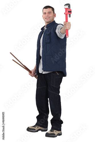 Plumber with wrench and pipe