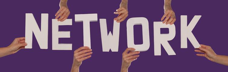 White alphabet lettering spelling NETWORK