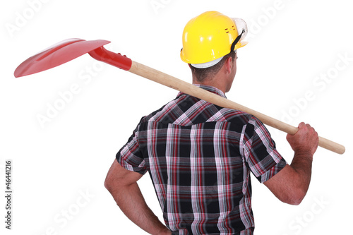 craftsman holding a shovel on his shoulder