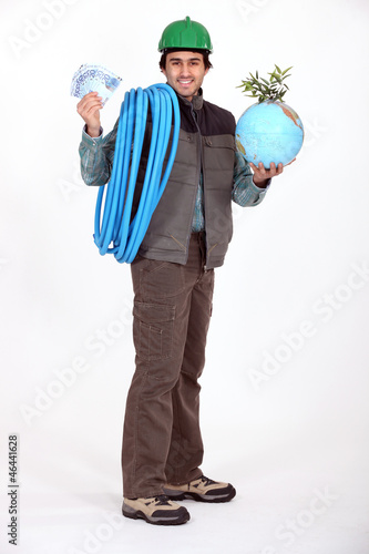 Construction worker holding a globe and a wad of bills