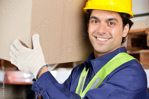 Young Foreman Lifting Cardboard Box