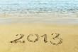 """The inscription """"2013"""" on a beach sand"""