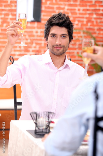 Man toasting in restaurant