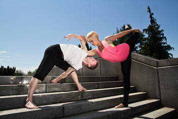 Young Couple Practicing Contemporary Dance Exercise on Stairs