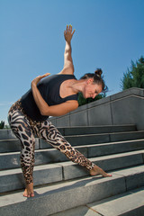 Young Female Practicing Contemporary Dance Exercise on Stairs