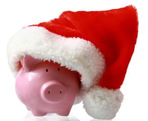 Piggy bank wearing a santa hat - Christmas savings