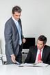 Businessmen calculating finances