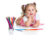 Cute girl drawing a picture with color pencils