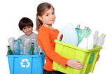 Children recycling plastic bottles