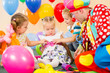 children and clown on birthday party