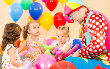 children girls and clown on birthday party
