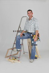 Tradesman posing with his building materials
