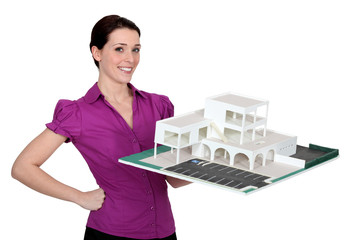 woman holding a model building