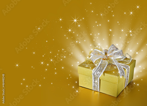 Golden surprise gift box or present with ribbon, bow, stars