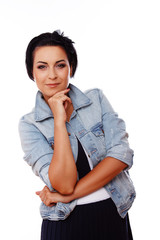 Portrait of beautiful woman posing on white background in jeans