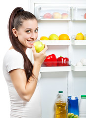 cute girl near the open refrigerator