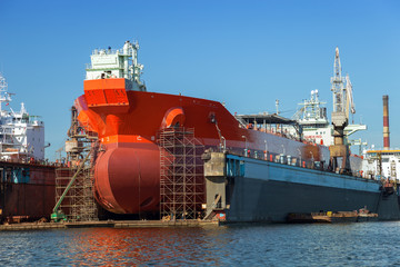 A large tanker repairs in dry dock