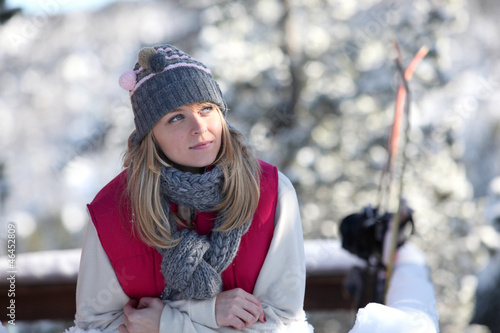 Blond woman stood by chalet
