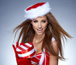 Santa girl on snow blue background