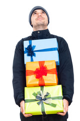 Happy man holding Christmas gift boxes
