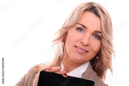 Portrait of 40 years old woman in office suit smiling with lapto