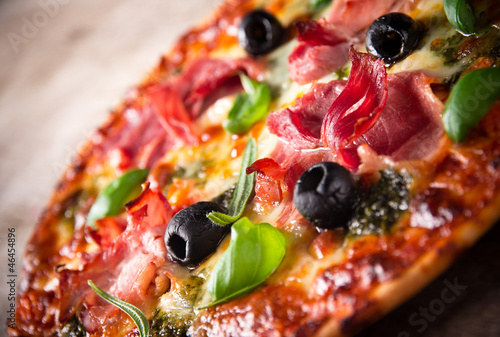 Tasty Italian pizza on wooden background - 46454896