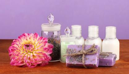 ingredients for soap making on violet background