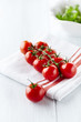 Cherry tomatoes on white kitchen towel