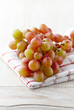 Bunch of grapes on kitchen towel