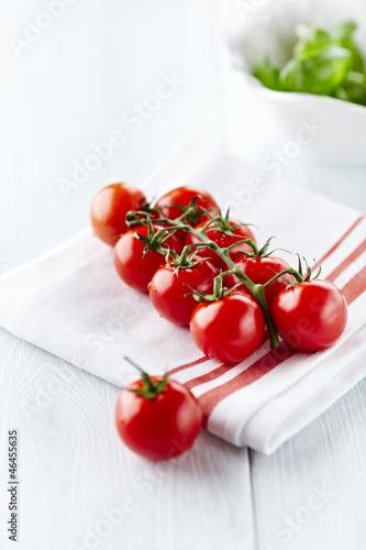 Cherry tomatoes on white kitchen towel