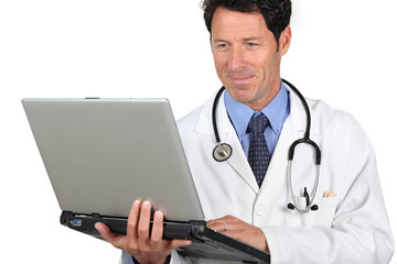 Doctor holding laptop computer