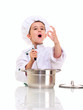 Little singing boy chef in uniform with ladle stiring in the pot