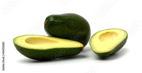 Cut avocado isolated on white background