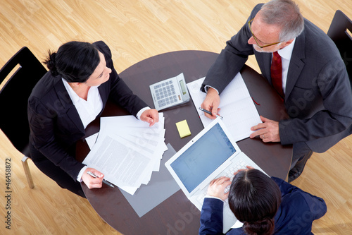 Meeting with three business people