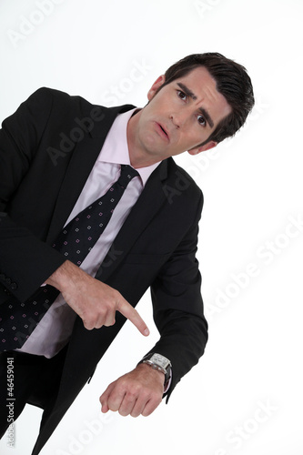 Angry boss pointing to his watch